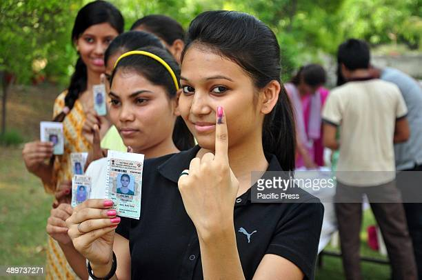 First time voter A young girl showing her dyed finger after she and other young women had cast their votes on 8th phase of Loksabha Election in...