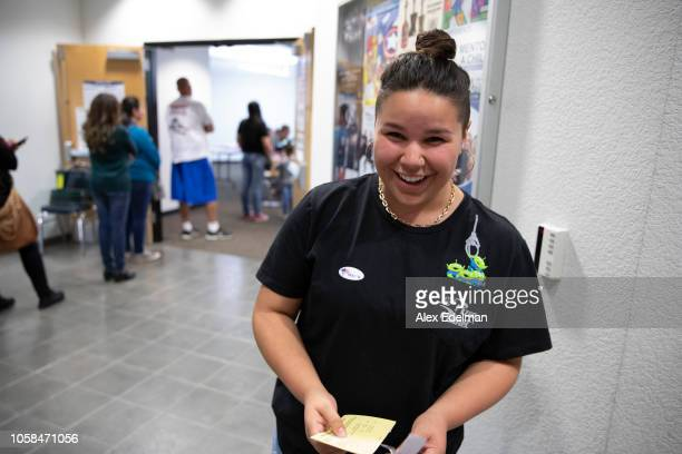 First time voter Delilah Freytes 18 of Salida smiles after putting on her I Voted sticker after voting a polling location on November 6 2018 in...