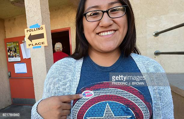 First time voter Sonia Orea points to her sticker after voting at the Brooklyn Avenue Elementary School in the primarily Latino East LA neighborhood...