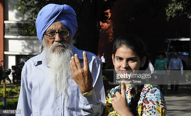First time voter with her grandfather showing their inked finger after casting her vote at Government Model Senior Secondary School Sec-18 on April...