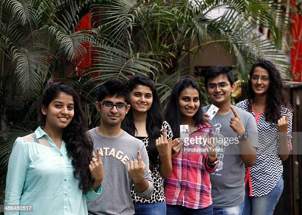 First time voters showing their ink stained fingers after casting their votes for Lok Sabha polls on April 24 2014 in Mumbai India High voter...