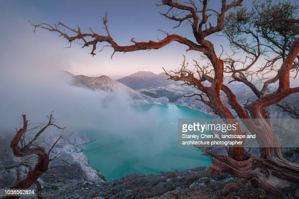 first touch of light in ijen volcano - java stock pictures, royalty-free photos & images
