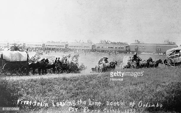 First train and wagons leaving the line north of Orlando [Orlembo] for Perry Oklahoma Territory September 16 1893 | Location Oklahoma Territory