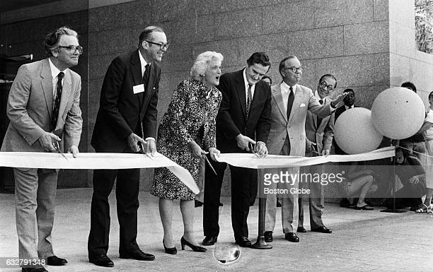 First Vice Lady Barbara Bush center cuts the ribbon at the opening of a new wing at the Museum of Fine Arts in Boston on July 17 1981 From left with...