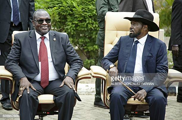 First Vice President of South Sudan and former rebel leader Riek Machar and President Salva Kiir sit for an official photo with the 30 members of the...