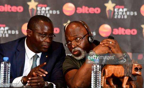 First vicepresident of The African Football Federation Amaju Pinnick speaks with President of Senegalese Football Federation Augustin Senghor during...