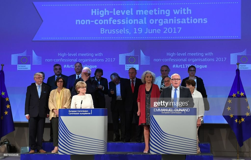 First Vice-President of the European Commission Frans Timmermans (R), First Vice-President of the European Parliament Mairead McGuinness (L) in the presence of representatives of philosophical and non-confessional organisations address a press conference on the occasion of their high-level meeting on Article 17 of the Lisbon Treaty at the European Commission in Brussels on June 19, 2017. /