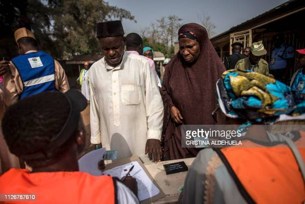 First voters cast their ballots at Unguwar Sarki polling station in Kaduna on February 23 as Nigeria votes to elect its new president Nigerians began...
