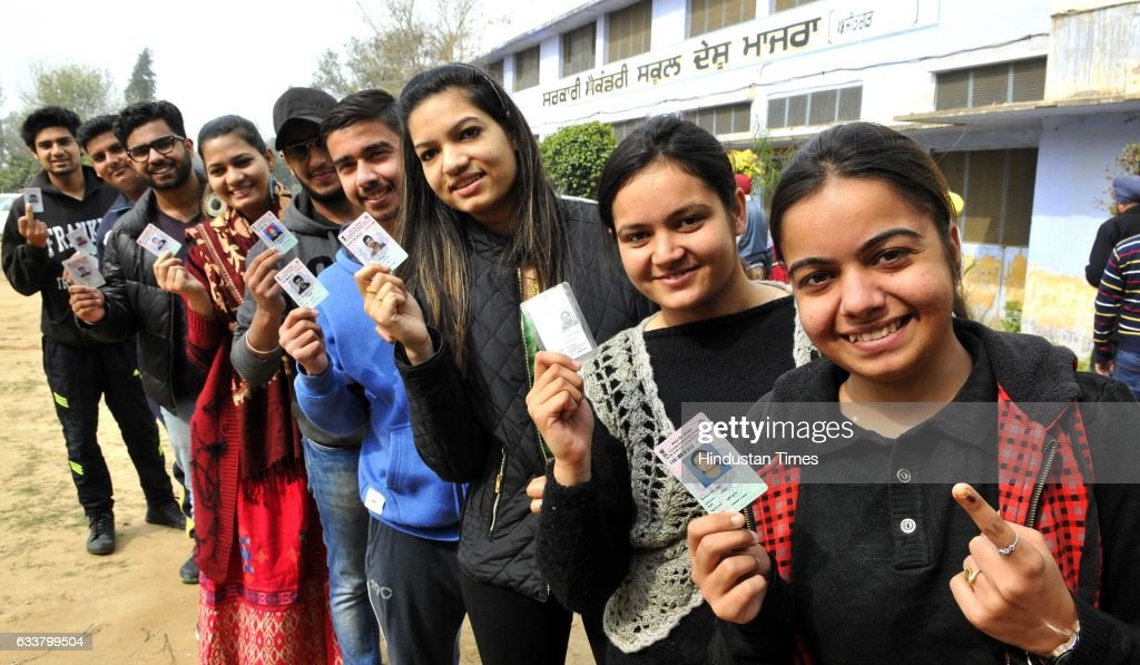 First voters showing voter cards during Punjab election 2017 at Balongi near SAS Nagar on February 4 2017 in Mohali India Punjab on Saturday voted in.