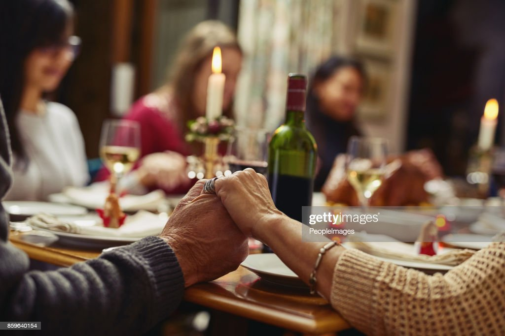First we pray then we feast : Stock Photo