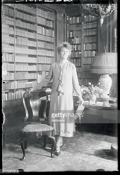 First woman alderman New York Photo shows Mrs John T Pratt the Associate leader of the Fifteenth Assembly District in her study as she receives...