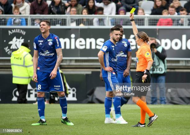 First woman ro referee a Ligue 1 match Stephanie Frappart gives a yellow card to Jonas Martin of Strasbourg during the French Ligue 1 match between...