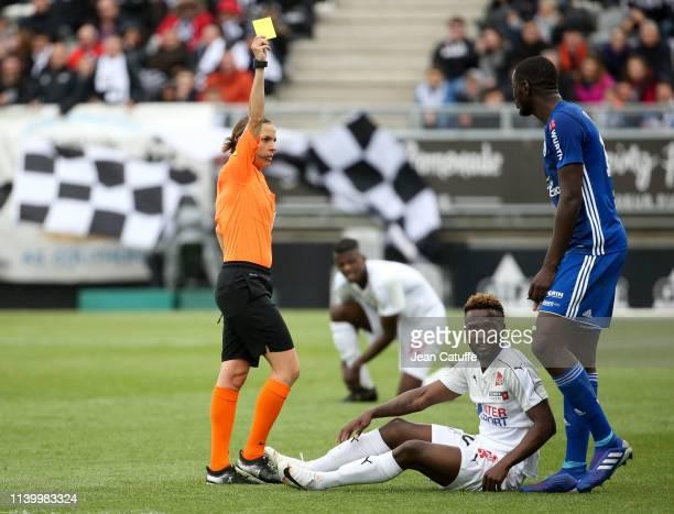 First woman to referee a Ligue 1 match Stephanie Frappart gives a yellow card to Ibrahima Sissoko of Strasbourg during the French Ligue 1 match...