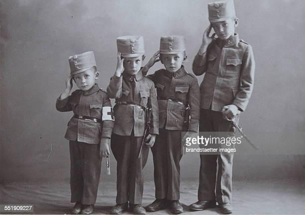 First World War 19141918 'In war in 191 ' Four children in kuk Uniform 1916 Photograph by Eugen Veit / Vienna