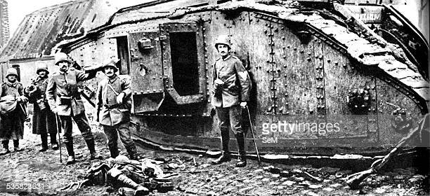 First World War, 1918. British tank captured by German infantry on the Western Front on the ground the bodies of the British tank crews.