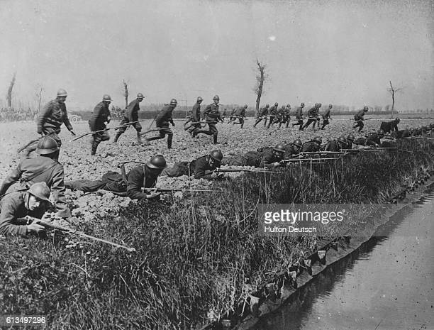 First World War Belgian troops run to take up position along the banks of a canal near the Ypres salient In the first Battle of Ypres October 1914...