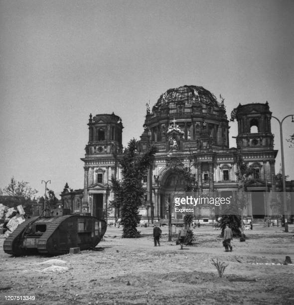 A First World War British Mark V tank stands abandoned outside the bomb damaged ruins of the Berlin Cathedral following the allied occupation in July...