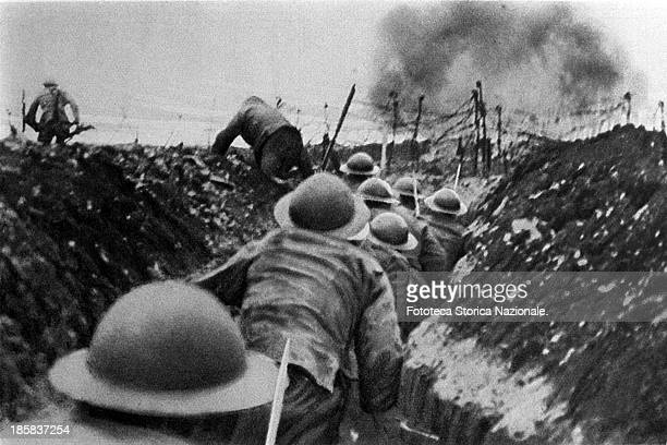 Soldiers of the English infantry in France, running out of their trenches at the signal to assault . Somme, France 1916.