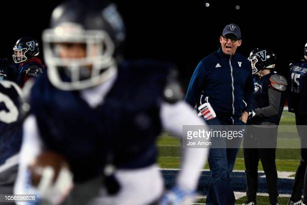 First year coach Ed McCaffrey working with the offense during practice at Valor Christian High School November 1 2018 in Highlands Ranch Colorado