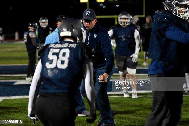 First year coach Ed McCaffrey working with the offense wanting power in their blocking during practice at Valor Christian High School November 1 2018...
