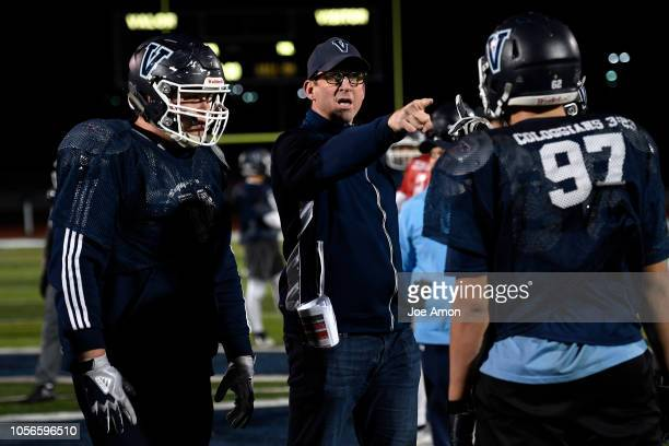 First year coach Ed McCaffrey working with the offensive line during practice at Valor Christian High School November 1 2018 in Highlands Ranch...
