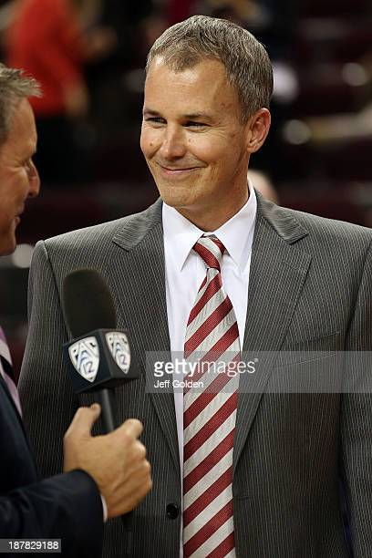 First year head coach Andy Enfield of the USC Trojans smiles as he is interviewed on the Pac12 Network after getting his first win at USC in the home...