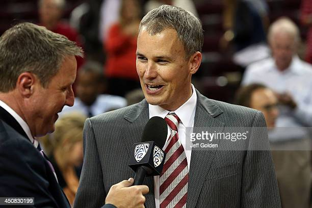 First year head coach Andy Enfield of the USC Trojans smiles as he is interviewed by Jim Watson on the Pac12 Network after getting his first win at...