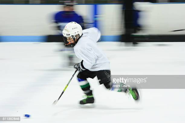 First year hockey player Jonathan Compton skates down ice during a drill at Edge Ice Arena on February 17 2016 in Littleton Colorado Hockey has...
