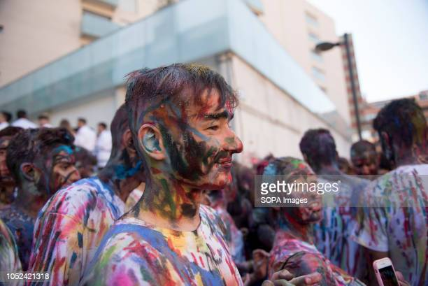 First year medicine student covered in paint during the celebrations of El Lucas in Granada with the traditional hazing of new students and the...