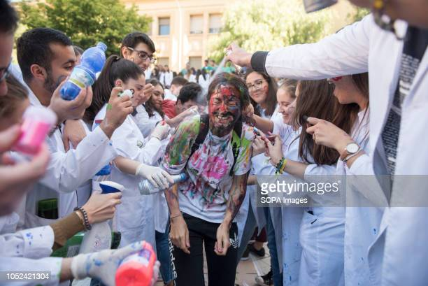 First year medicine student is seen being painted by his classmates during the celebrations of El Lucas in Granada with the traditional hazing of new...