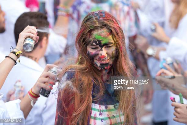 First year medicine student is seen being painted during the celebrations of El Lucas in Granada with the traditional hazing of new students and the...
