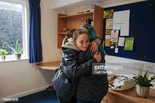 First year student at Falmouth University Helena Crate hugs farewell to her fellow student friend Amy Coe before returning home to Suffolk on...