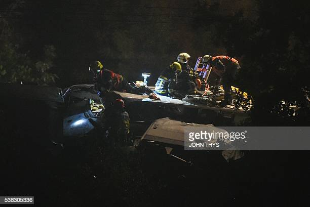 Firstaid personnel work on the scene following a collision between a goods train and a passenger train on June 5 2016 near SaintGeorgessurMeuse...