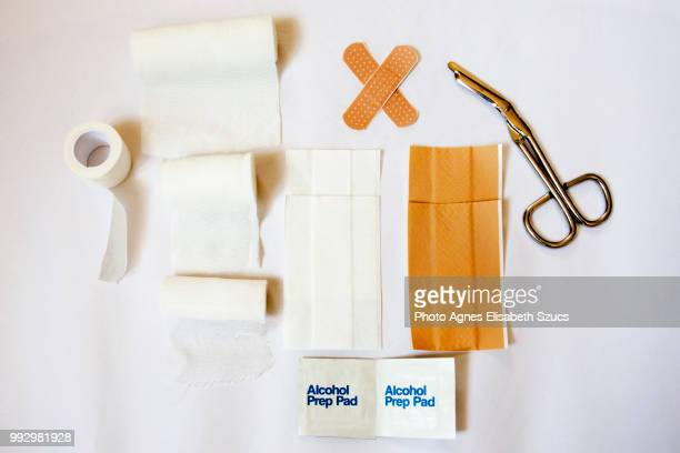 first-aid plasters and bandages - gauze stock pictures, royalty-free photos & images