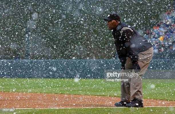 Firstbase umpire Chuck Meriwether watches play through a snow squall as the Baltimore Orioles defeated the Cleveland Indians 65 in 13 innings in an...