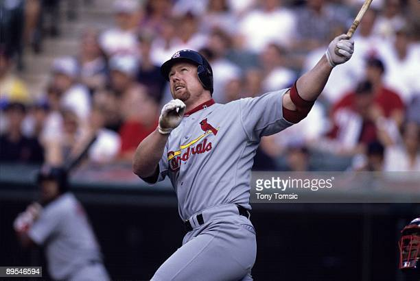 Firstbaseman Mark McGwire of the St Louis Cardinals hits a home run during the top of the first inning of a game in June 25 1998 against the...
