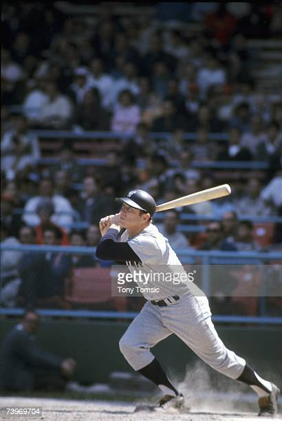 Firstbaseman Mickey Mantle of the New York Yankees homers to centerfield off Gary Bell of the Cleveland Indians during the sixth inning of a game on...