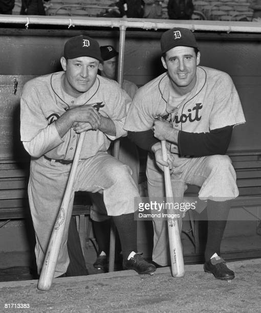 Firstbaseman Rudy York and outfielder Hank Greenberg of the Detroit Tigers pose for a portrait on the dugout steps prior to a World Series game in...