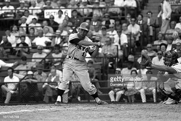 Firstbaseman Sadaharu Oh of the Tokyo Giants of the Japanese Central League strides into a pitch during a Spring Training game in March 1971 against...