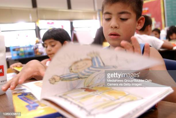 Firstgrader Misael Garcia flips a page while reading a book in Spanish called Pica Pica Varicela during reading period in Cynthia Montanez class at...