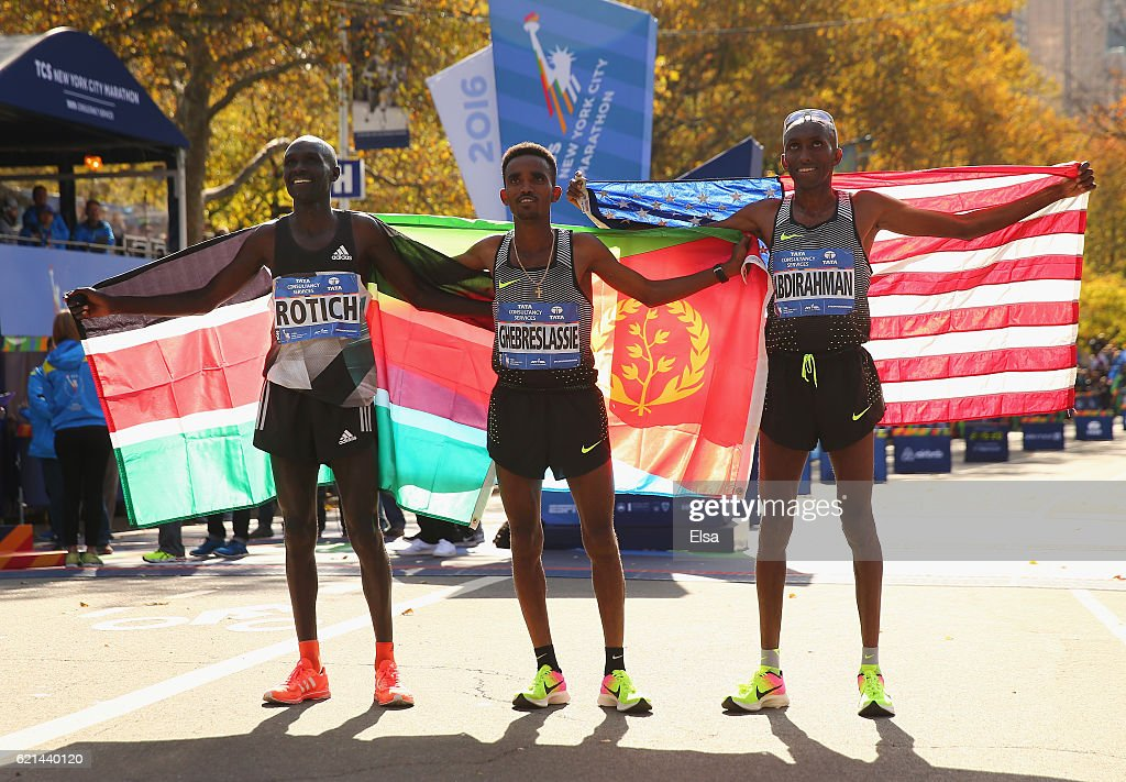 First-place finisher Ghirmay Ghebreslassie (C) of Eritrea, second-place finisher Lucas Rotich (L) of Kenya and third-place finisher Abdi Abdirahman (R) of the United States celebrate after the Professional Men's Division during the 2016 TCS New York City Marathon in Central Park on November 6, 2016 in New York City.
