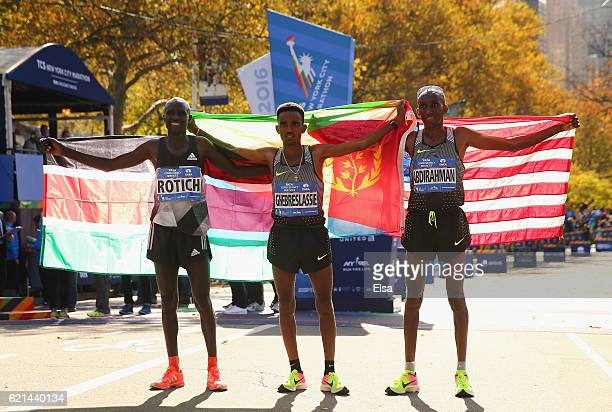Firstplace finisher Ghirmay Ghebreslassie of Eritrea secondplace finisher Lucas Rotich of Kenya and thirdplace finisher Abdi Abdirahman of the United...