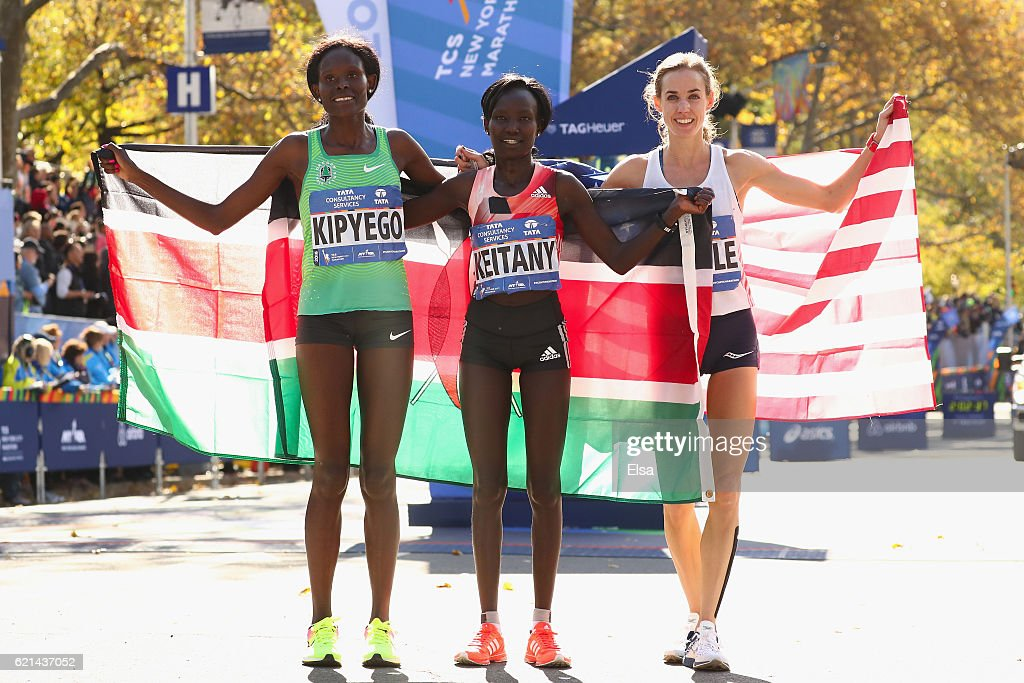 First-place finisher Mary Keitany (C) of Kenya, second-place finisher Sally Kipyego (L) of Kenya and third-place finisher Molly Huddle (R) of the United States celebrate after finishing first in the Professional Women's Division during the 2016 TCS New York City Marathon in Central Park on November 6, 2016 in New York City.