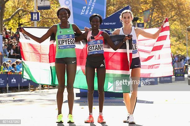 Firstplace finisher Mary Keitany of Kenya secondplace finisher Sally Kipyego of Kenya and thirdplace finisher Molly Huddle of the United States...