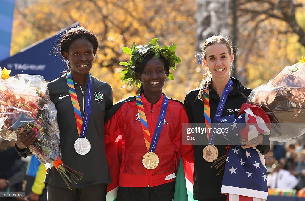 First-place finisher Mary Keitany (C) of Kenya, second-place finisher Sally Kipyego (L) of Kenya and third-place finisher Molly Huddle (R) of the United States celebrate with their medals after the Professional Women's Division during the 2016 TCS New York City Marathon in Central Park on November 6, 2016 in New York City.