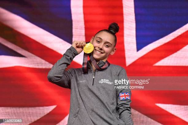 First-placed Britain's Jessica Gadirova celebrates on the podium during the award cermenony after competing in the Women's floor apparatus final of...