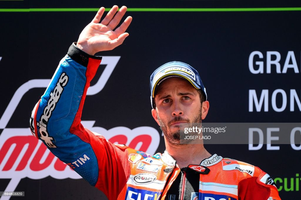 First-placed Ducati Team's Italian rider Andrea Dovizioso celebrates on the podium after winning the Moto GP race of the Catalunya Grand Prix at the Montmelo racetrack near Barcelona on June 11, 2017. / AFP PHOTO / Josep LAGO