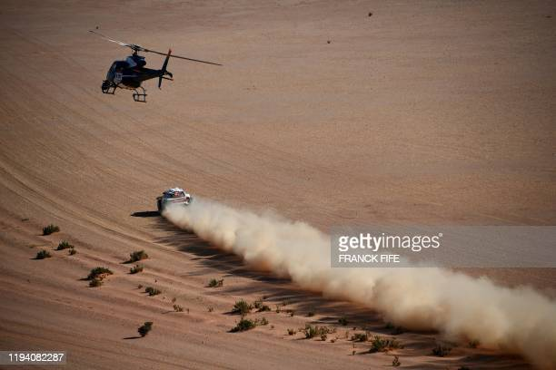 First-placed for the auto category JCW X-RAID Mini Team Spain's driver Carlos Sainz competes during the stage 12 of the Dakar 2020 between Haradh and...