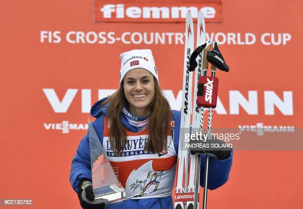 Firstplaced Heidi Weng of Norway poses on the podium after the Women's 9 km Pursuit Free Final Climb race of the FIS World cup Tour de Ski at Val Di...