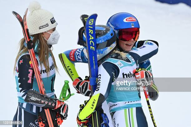 First-placed New Zealand's Alice Robinson, second-placed US Mikaela Shiffrin and third-placed Slovenia's Meta Hrovat celebrate in the finishing area...